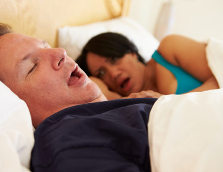 Couple Asleep In Bed With Man Snoring